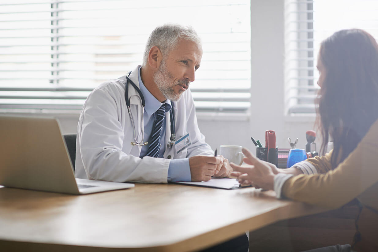 physician-answering-questions-with-patient